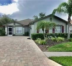 Photo of 8018 SHADDOCK PLACE, LAND O LAKES, FL 34637 (MLS # W7828285)