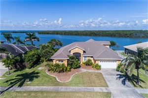Photo of 33 HARBOR CIRCLE, COCOA BEACH, FL 32931 (MLS # O5730296)