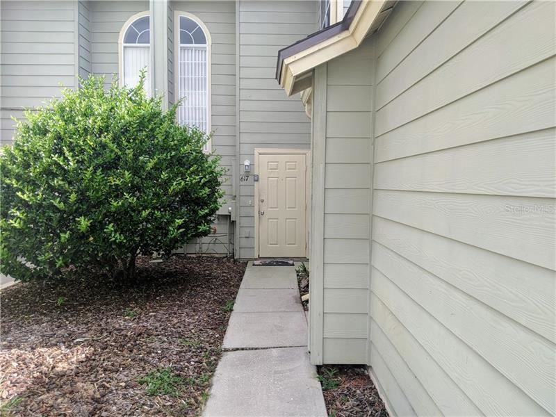 Photo of 617 ORCHID DRIVE, DAVENPORT, FL 33897 (MLS # O5811296)