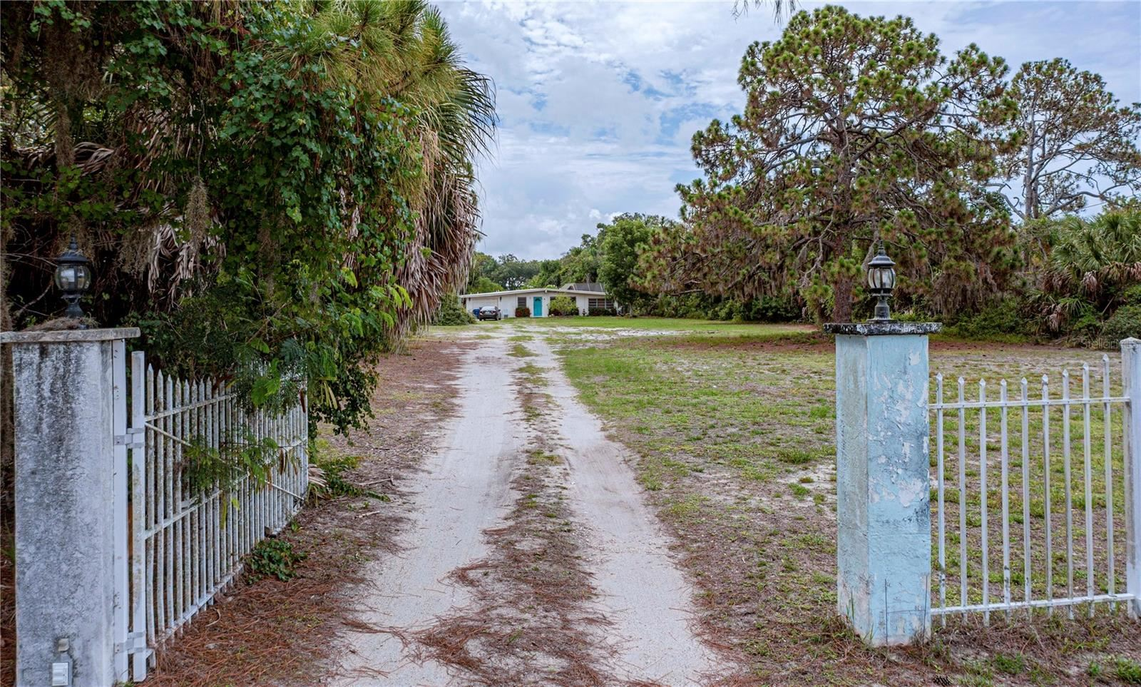 Photo of 1628 BAYSHORE DRIVE, ENGLEWOOD, FL 34223 (MLS # D6119298)