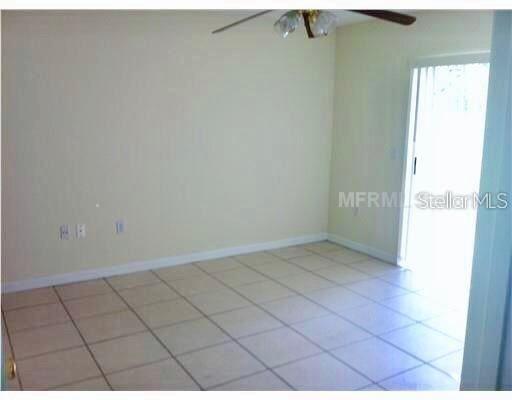 Photo of 13087 ODYSSEY LAKE WAY, ORLANDO, FL 32826 (MLS # O5869298)