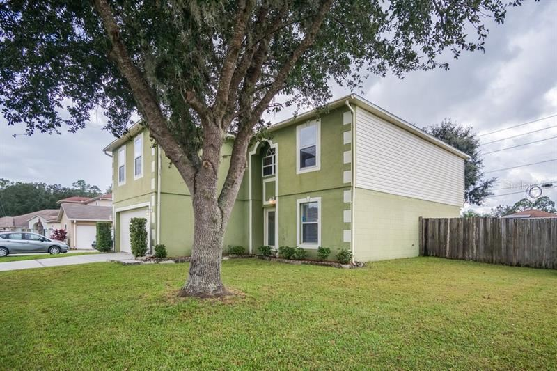 Photo of 102 CASTLEFORD WAY, KISSIMMEE, FL 34758 (MLS # O5902298)