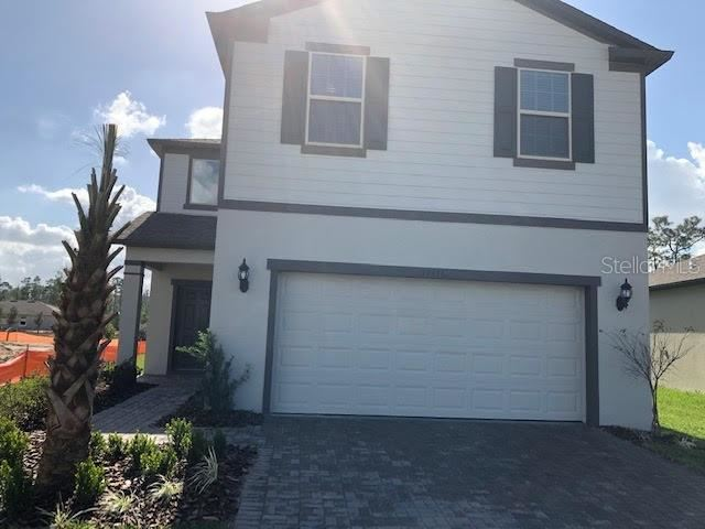 Photo of 17176 GOLDCREST LOOP, CLERMONT, FL 34714 (MLS # O5902300)