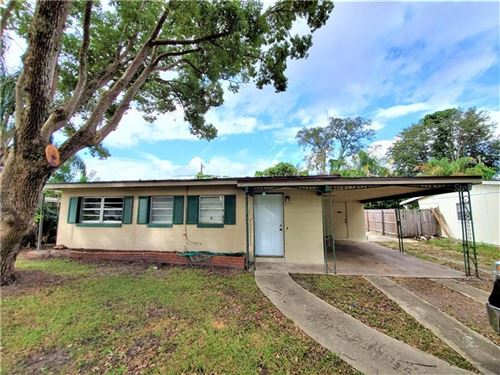 Photo of 8211 DOMINGUIN STREET, ORLANDO, FL 32817 (MLS # O5903301)