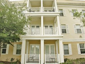 Photo of 7507 MOURNING DOVE CIRCLE #103, REUNION, FL 34747 (MLS # O5743303)
