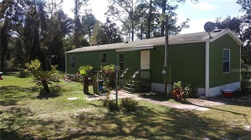 Photo of 18498 SE 16TH PLACE, SILVER SPRINGS, FL 34488 (MLS # OM600313)