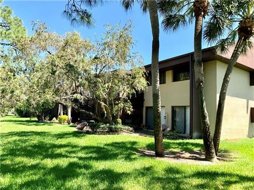 Photo of 880 S VILLAGE DRIVE N #201, ST PETERSBURG, FL 33716 (MLS # U8118319)
