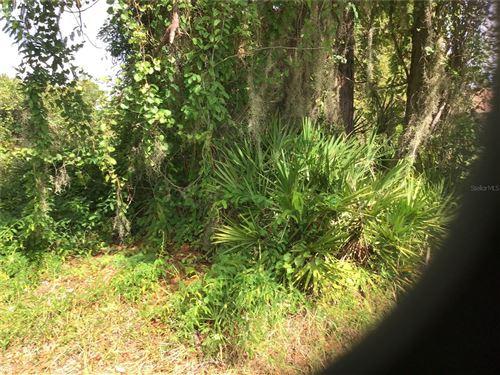 Photo of 8040 GROVE BOULEVARD, PUNTA GORDA, FL 33982 (MLS # D6121323)