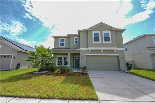Photo of 12233 PRAIRIE PLANTATION WAY, ORLANDO, FL 32824 (MLS # O5880325)