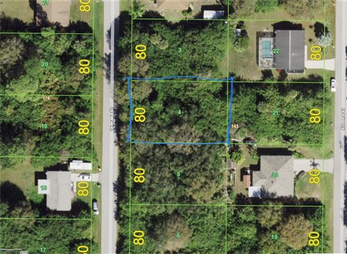 Photo of 161 GRENADA STREET NW, PORT CHARLOTTE, FL 33948 (MLS # C7450327)