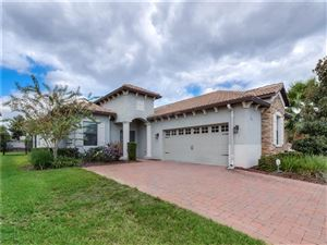 Photo of 1318 ISLAND GREEN STREET, CHAMPIONS GATE, FL 33896 (MLS # O5819327)