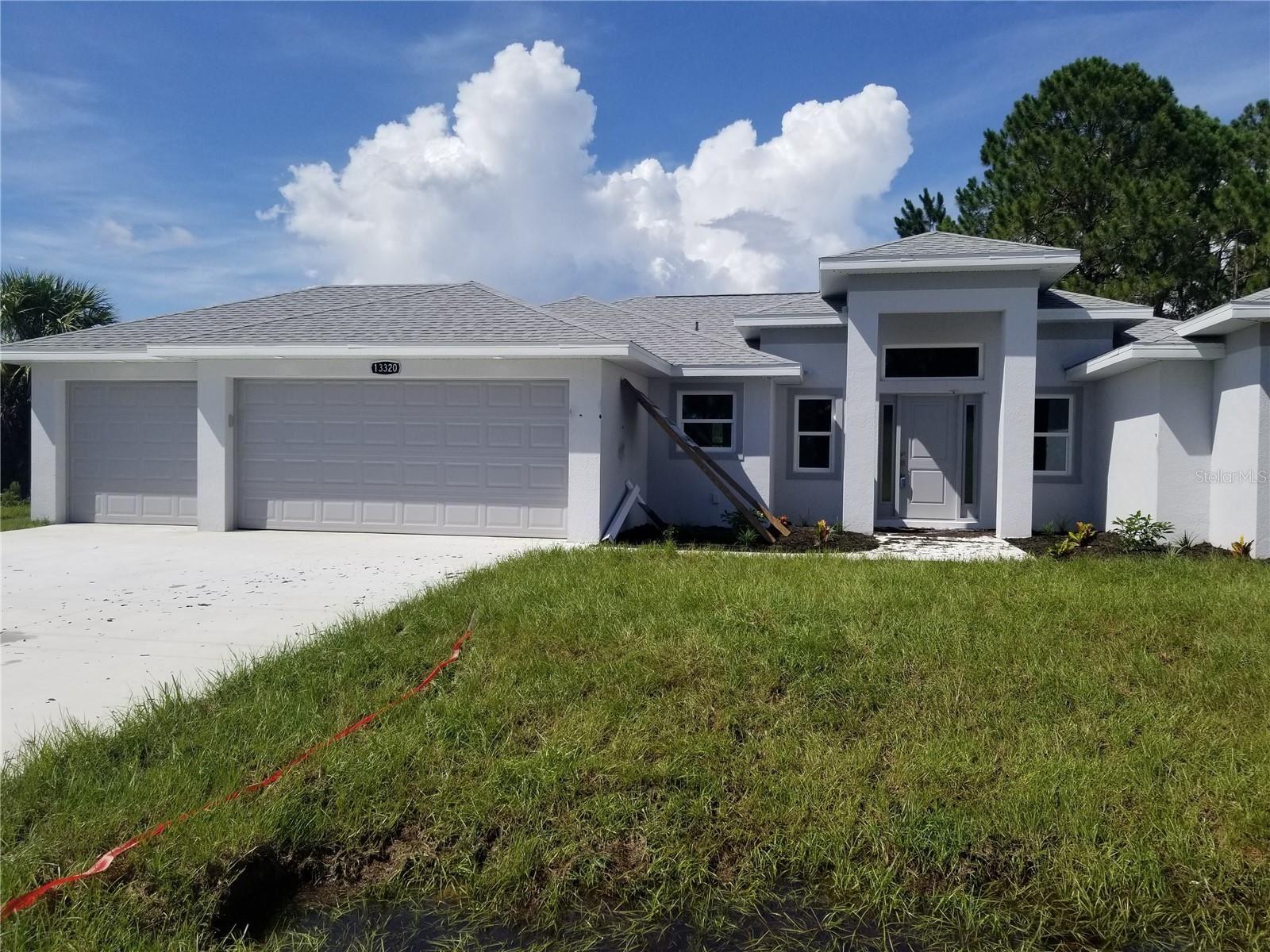 Photo of 13320 GERSHWIN LANE, PORT CHARLOTTE, FL 33981 (MLS # C7446327)