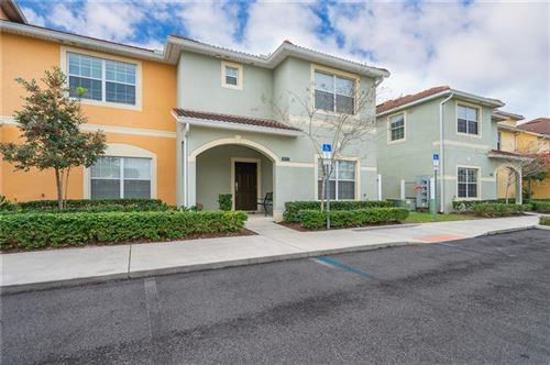 Photo of 8932 MAJESTY PALM ROAD, KISSIMMEE, FL 34747 (MLS # O5841329)