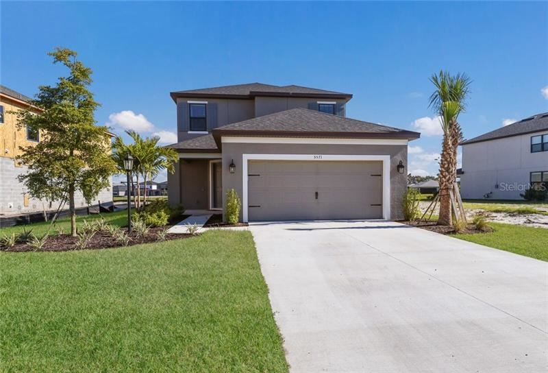 Photo of 5571 SUMMIT GLEN, BRADENTON, FL 34203 (MLS # A4487336)