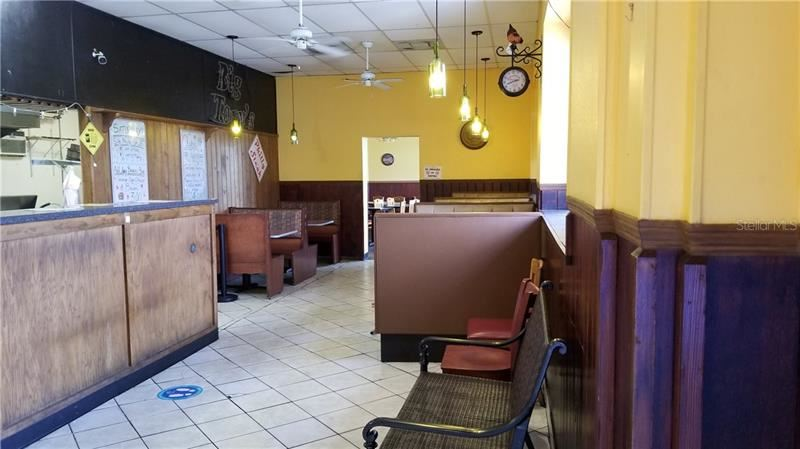 Photo of 201 E HINSON AVENUE, HAINES CITY, FL 33844 (MLS # P4915336)