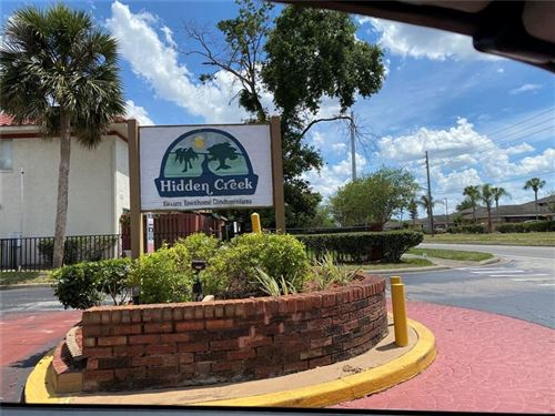 Photo of 1609 LITTLE FALLS CIRCLE #79, ORLANDO, FL 32807 (MLS # O5938337)