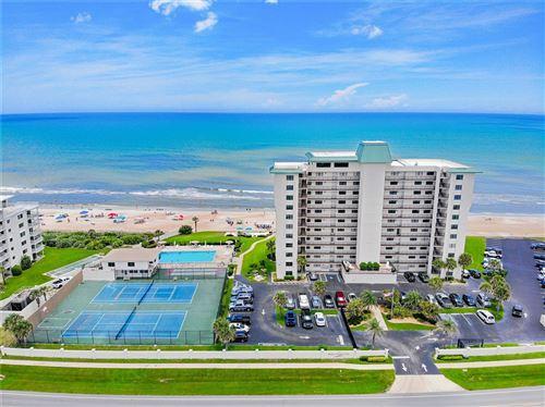 Photo of 5499 S ATLANTIC AVENUE #405, NEW SMYRNA BEACH, FL 32169 (MLS # O5960341)