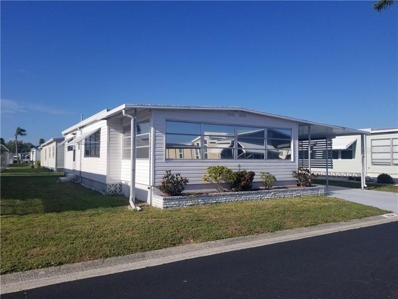 Photo of 3224 SWEET GUM TERRACE, SARASOTA, FL 34237 (MLS # A4467345)