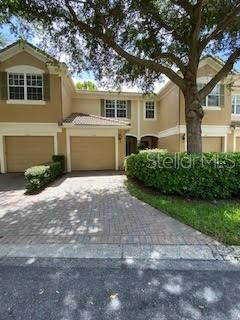 Photo of 3542 SHALLOT DRIVE #106, ORLANDO, FL 32835 (MLS # O5880353)