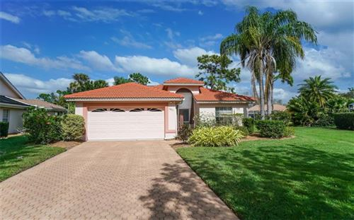 Photo of 5831 FAIRWOODS CIRCLE, SARASOTA, FL 34243 (MLS # A4460355)