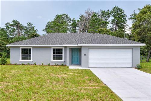 Photo of 3874 SW 133RD LOOP, OCALA, FL 34473 (MLS # OM624360)