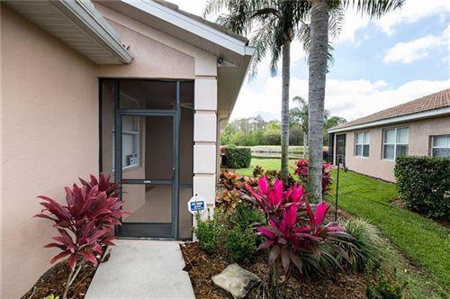 Photo of 387 FAIRWAY ISLES LANE, BRADENTON, FL 34212 (MLS # A4483365)