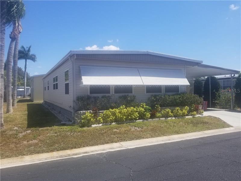Photo of 11 RED MAPLE TERRACE, SARASOTA, FL 34237 (MLS # A4463372)