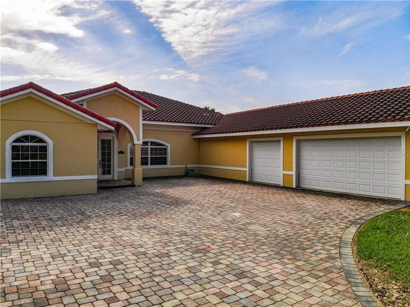 Photo of 12844 BELLERIVE DR, CLERMONT, FL 34711 (MLS # O5937375)