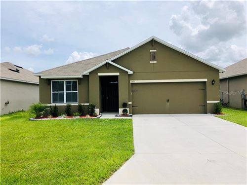 Photo of 360 HOLLY BERRY DRIVE, DAVENPORT, FL 33897 (MLS # O5869376)