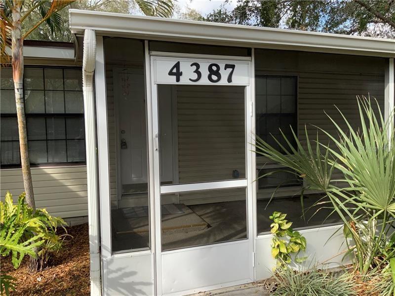 Photo of 4387 E MICHIGAN STREET #4387, ORLANDO, FL 32812 (MLS # O5847376)