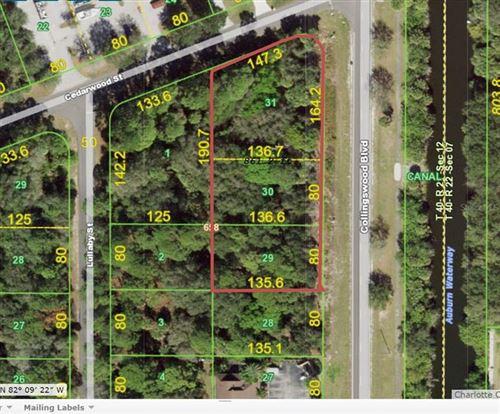 Photo of 1369 COLLINGSWOOD BLVD, PORT CHARLOTTE, FL 33948 (MLS # C7442382)