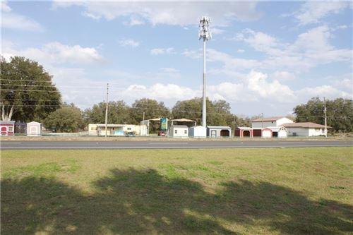 Photo of 8680 SE 143RD LANE, SUMMERFIELD, FL 34491 (MLS # OM615387)