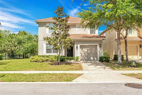 Photo of 8991 CUBAN PALM ROAD, KISSIMMEE, FL 34747 (MLS # O5789391)