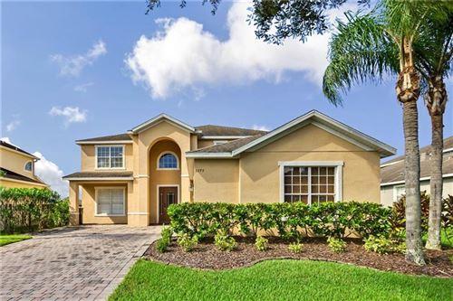 Photo of 5775 COVINGTON COVE WAY, ORLANDO, FL 32829 (MLS # O5893397)