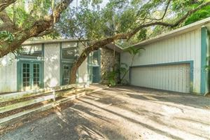 Photo of 2212 SHADOW WOOD LANE, SARASOTA, FL 34240 (MLS # O5805399)
