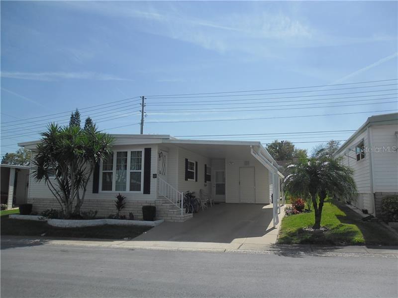 83 RED OAK DRIVE, Palm Harbor, FL 34684 - #: U8077399
