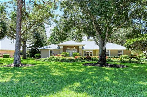 Photo of 4384 MAPLEWOOD LANE, SARASOTA, FL 34238 (MLS # A4507403)