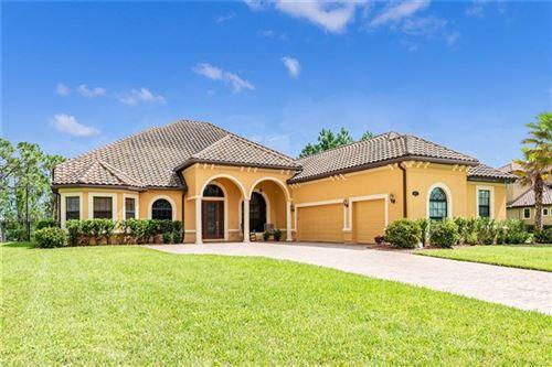 Photo of 14131 OAKWOOD COVE LANE, ORLANDO, FL 32832 (MLS # O5914403)