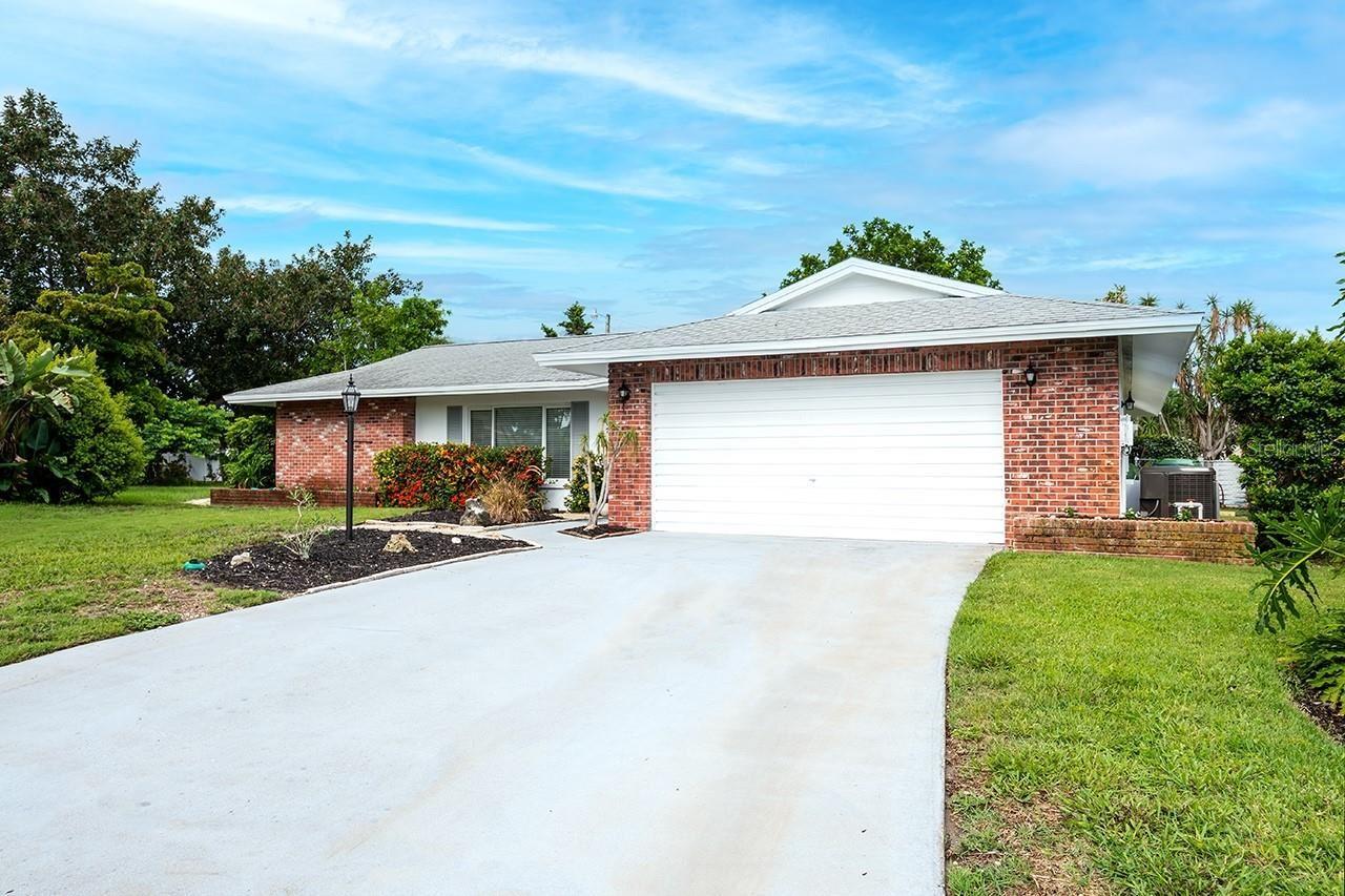 Photo of 7409 13TH AVENUE W, BRADENTON, FL 34209 (MLS # A4508404)