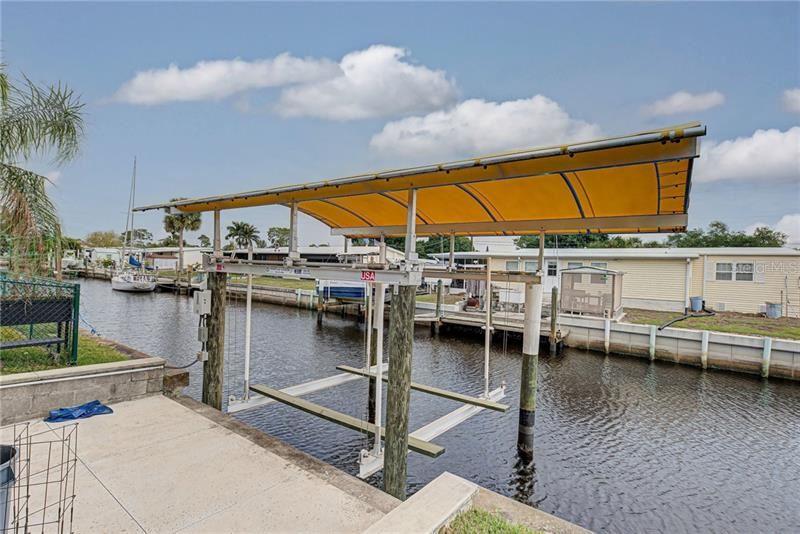 Photo of 4164 NETTLE ROAD, PORT CHARLOTTE, FL 33953 (MLS # C7440408)
