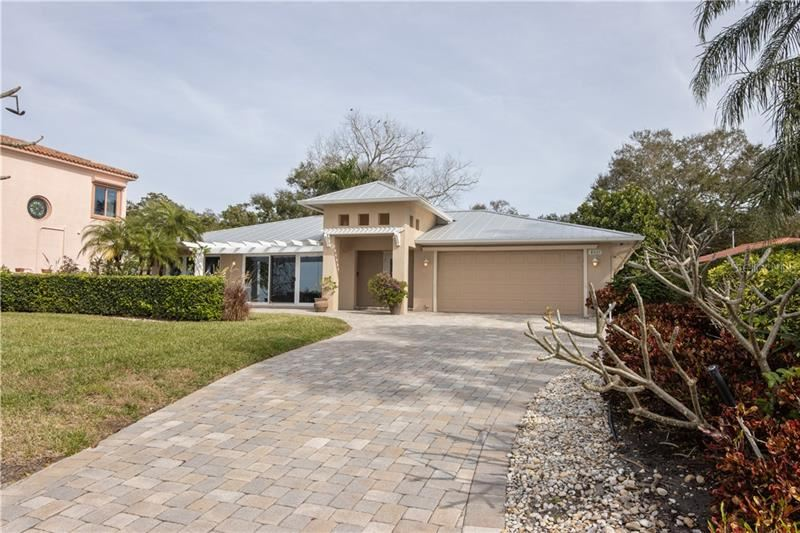 Photo of 8037 LONGBAY BOULEVARD, SARASOTA, FL 34243 (MLS # A4458415)