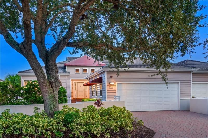 Photo of 3427 WINDING OAKS DRIVE #14, LONGBOAT KEY, FL 34228 (MLS # A4480415)