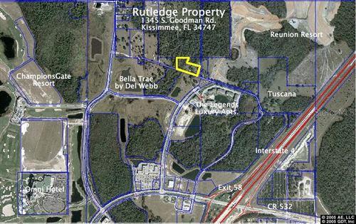 Photo of 1345 S GOODMAN RD, CHAMPIONS GATE, FL 33896 (MLS # R4702417)