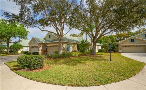 Photo of 5047 LAKESCENE PLACE, SARASOTA, FL 34243 (MLS # A4459418)