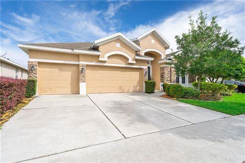 Photo of 8483 LAKE WAVERLY LANE, ORLANDO, FL 32829 (MLS # O5900424)