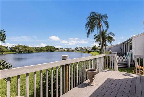 Photo of 930 WATERSIDE LANE, BRADENTON, FL 34209 (MLS # A4476425)