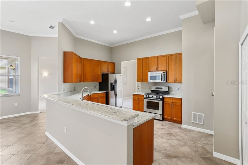 Photo of 2799 IMPERIAL POINT TER, CLERMONT, FL 34711 (MLS # O5868432)