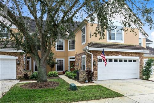 Photo of 7434 GREEN TREE DRIVE #110, ORLANDO, FL 32819 (MLS # O5916439)
