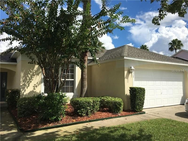 Photo of 1028 LAKE BERKLEY DRIVE, KISSIMMEE, FL 34746 (MLS # S5045443)