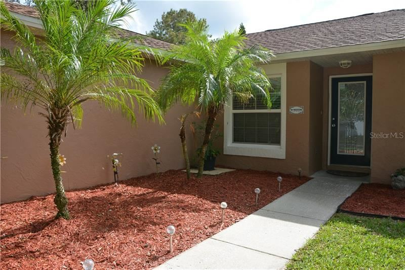 Photo of 11433 CRESCENT PINES BOULEVARD, CLERMONT, FL 34711 (MLS # O5902445)
